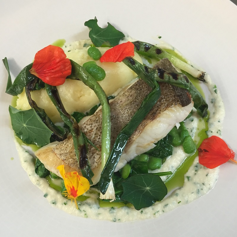 A special fish dish of pollock, mashed potatoes, broad beans, grilled leek, nasturtiums, parsley and brandade sauce